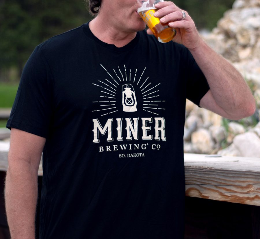 Black T-shirt with the Miner Lantern logo screenprinted across the chest