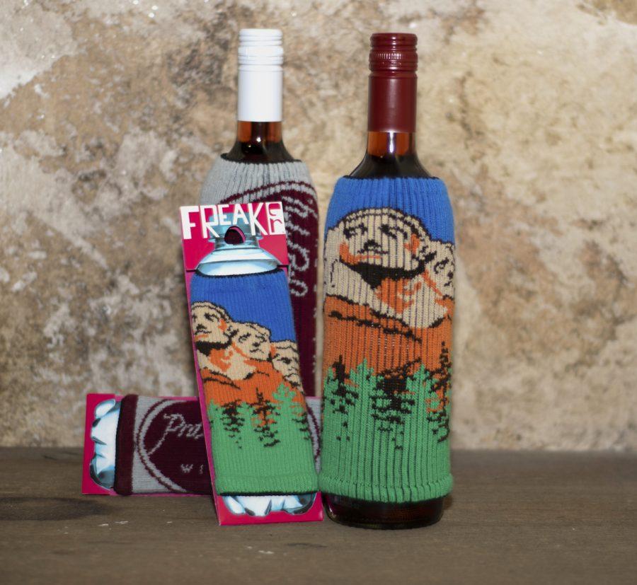 Mount Rushmore Freaker knit bottle sleeve on a bottle of wine